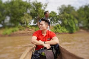 Crossing the river with dugout canoe